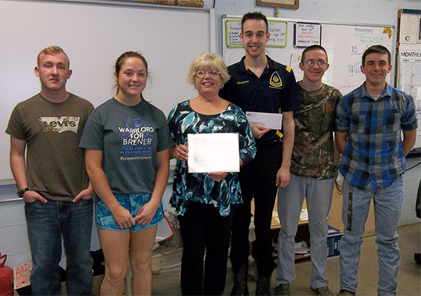 IEWC member Mary Zitek of the Association of Illinois Electric Cooperatives presented the award to Brandon Smith at Payson Seymour High School, Payson CUSD #1, in Payson, IL.